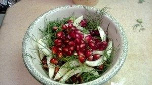 Pom seeds, fennel fronds, and fennel bulb salad inspired by Cicala's cold turkey dish.