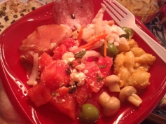 Awesome platter: prosciutto,coleslaw,mac'n cheese, marinade mushroom,green olives, water melon salad.