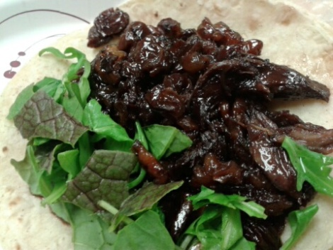 Pork cheek taco: golden raisins and dried cherries in a red wine reduction. Mustard greens and arugula.