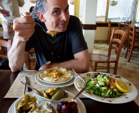 Director Roger Sherman enjoying humus and Israeli salads. Courtesy of Florentine Films.