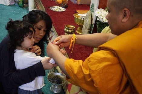 Catzie Vilayphonh & her daughter at a Lao New Year celebration.